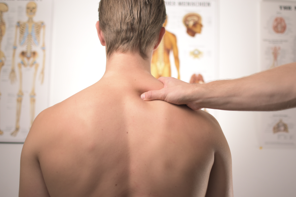 Chiropractor Taking Care of Patient with Neck Pain